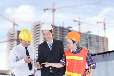 Engineer, supervisor and staff are checking the building construction. Stock Photo