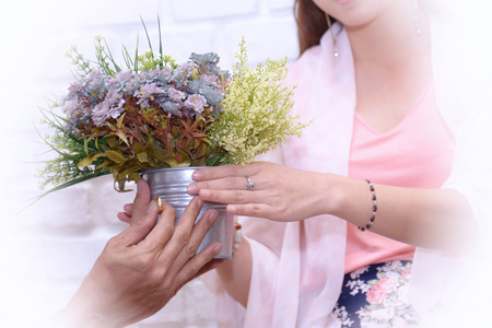 Will you marry me: young men preparing flowers and rings to propose marriage.