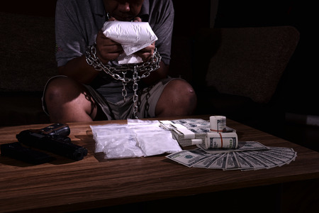 handcuffs: Those involved with drugs It was bound by the dark powers Stock Photo