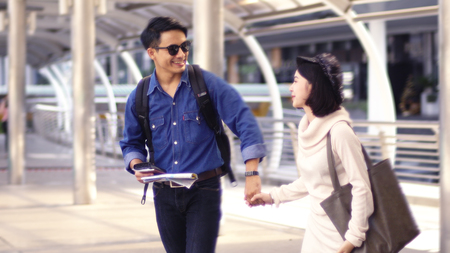 Young couple are happy to travel on the occasion of love.