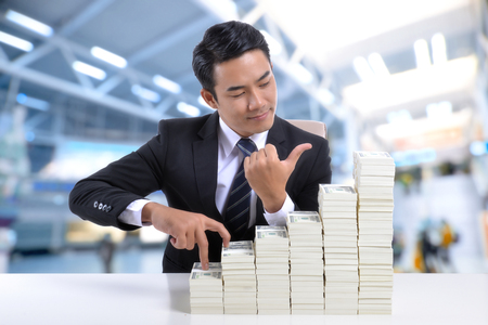Young businessman With finance, banking and stocks. Stock fotó