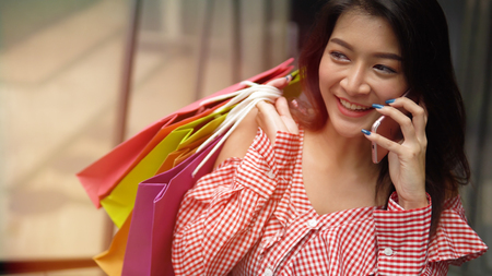 The adorable girl is happy with shopping in her free time