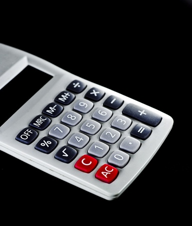 White calculator with black background. Stock Photo