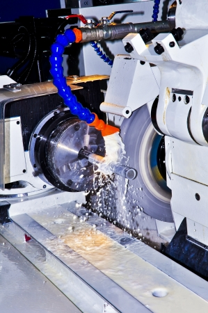 This photo about machine industry, is called cylindrical grinding.
