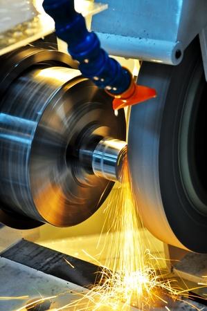 Deze foto over machine-industrie, heet rondslijpen. Stockfoto