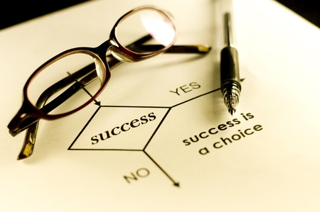 Ballpoint, glasses, and paper with diagram which describe success is choice. Stock Photo