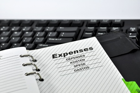 Expenses Note and Keyboard with white background. Stock Photo