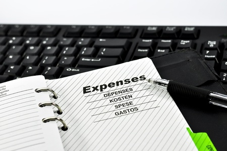 Expenses Notebook,pen and Keyboard with white background.