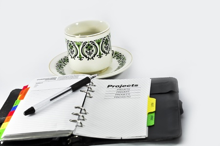 project note,Mug and ballpoin with white background Stock Photo