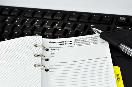 meeting note and keyboard with white background