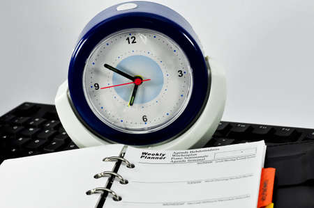 Weekly Planner Note,keyboar and clock with white background photo