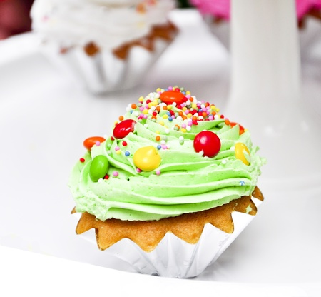 cream color: green cookies with candy Stock Photo