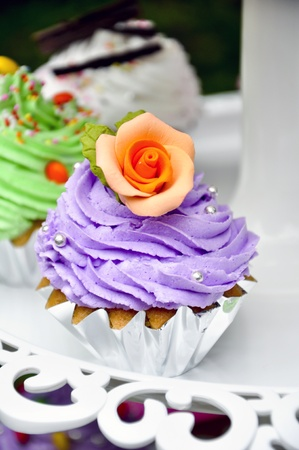 purple cookies cake with orange frower as decorated Stock Photo