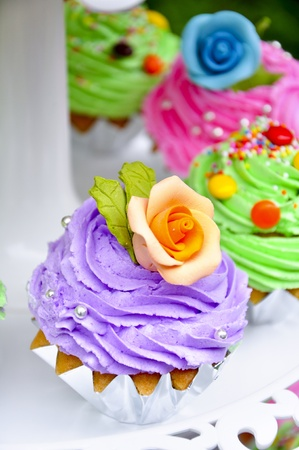 cup Cake with orange flower as decorate