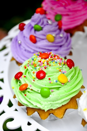 green cup cake with candy
