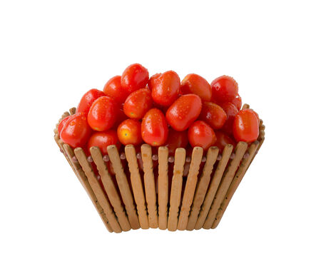Tomatoes in basket on white background photo