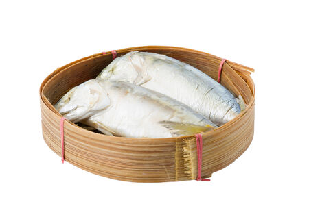 Mackerel in basket on white background photo
