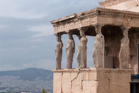 caryatids: Erechtheion temple dedicated to Athena and Poseidon at Acropolys of Athens in Greece Stock Photo