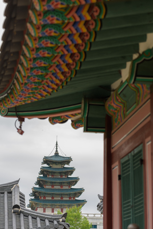 Distance view towards National Folk Museum of Korea under the typical Korean Roof, decorated with flowers Editorial