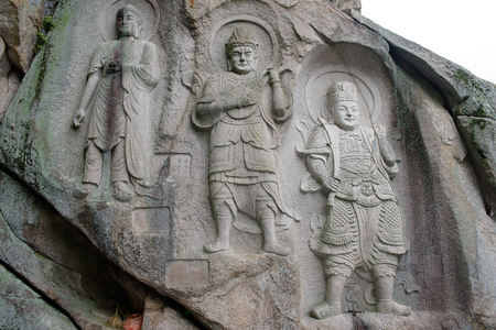 lotus lantern: Statues cut in stone, in Seokbulsa temple, Busan Stock Photo