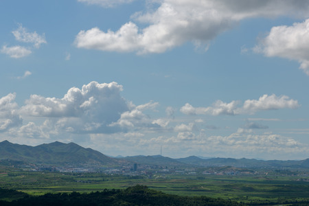 provincial tourist area: View towards North Korean city of Kaesong from Dorasan observatory during the sunny summer day Stock Photo