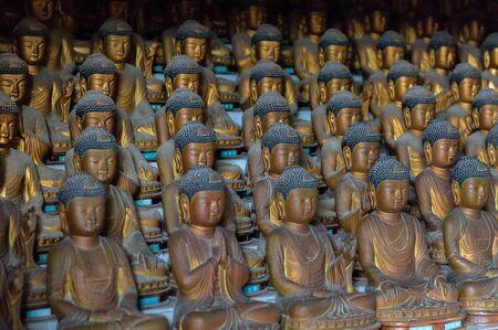 Busan South Korea, dozens of Buddhas inside the mountain Buddhist temple of Seokbulsa.