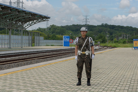 area of conflict: 2015-07-21 Dorasan Station- Demilitarized zone, South Korea - South Korean soldier is guarding the station exit which is leading to North Korea