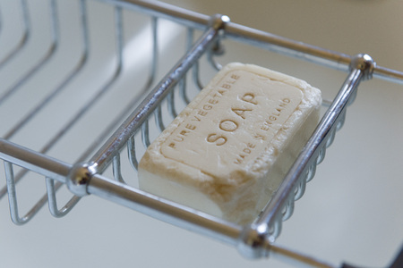 understated: Pure vegetable vintage soap above the bath Stock Photo