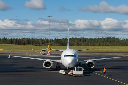 Pushback of aircraft from the gate at the airport Stock Photo