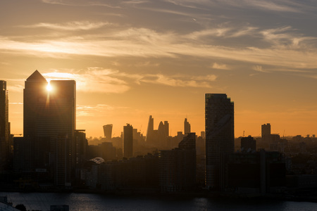 Sunset between skyscrapers in Canary Wharf District in London, United Kingdom