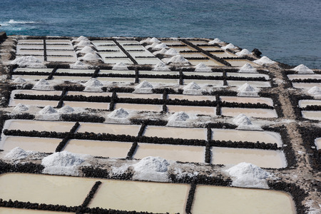 Traditional Manufacturing of Sea Salt by drying ocean water in La Palma, Spain Stock Photo