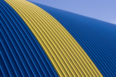 grooved: Blue - yellow tin roof Stock Photo