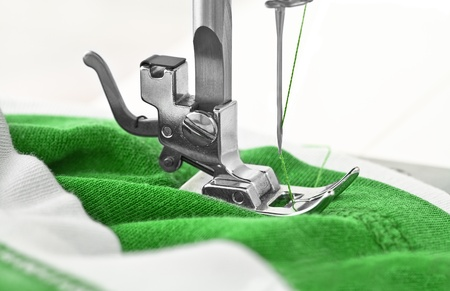 Sewing machine and item of clothing, detail Stock Photo