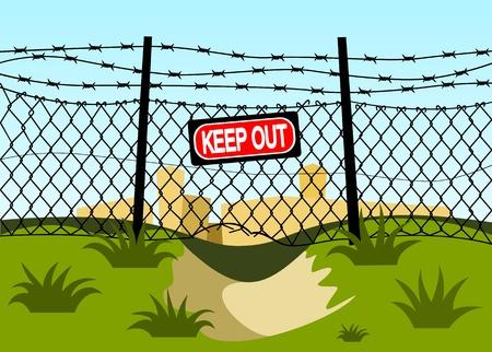Grillage avec des barbelés. Trou sous la clôture