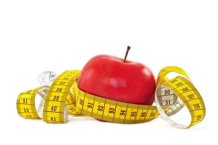 Pomme rouge et un ruban à mesurer