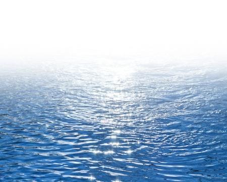 青色の輝く海水背景 写真素材