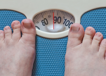 bathroom scale: Close-up of man feet weighing in bathroom