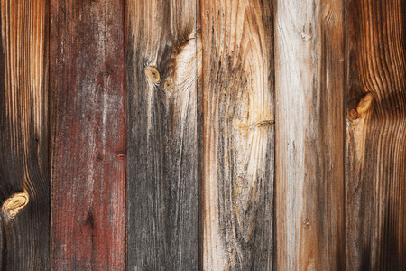 Old rustic weathered barn wood background with knots