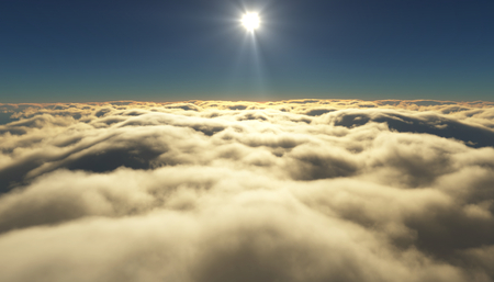 cloudy sky: View of a cloudy sunrise while flying above the clouds. Stock Photo