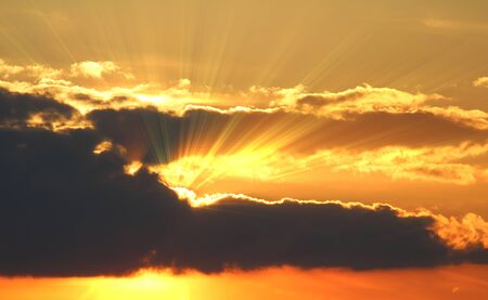 atmospheric: Sunset with clouds, light rays with atmospheric effect