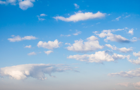 atmospheric: Clouds in the blue sky with atmospheric haze Stock Photo