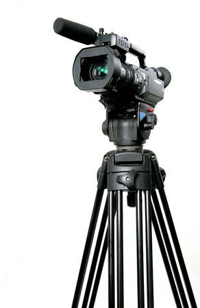 stand black mini-dv camcorder on black tripod Stock Photo