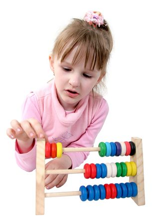 isolated little girl make some calculation with toy coloured wooden abacus photo
