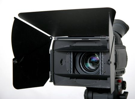 black high-definition camcorder with compendium on the tripod Stock Photo