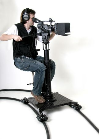 film crew: cameraman work with high-definition camcorder on the dolly