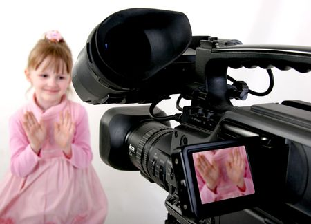 stand hd-camcorder shoot a hands of little girl in pink dress