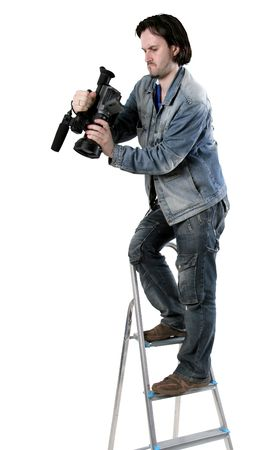 stepladder: isolated cameraman work with dv handy camcorder from the step-ladder Stock Photo
