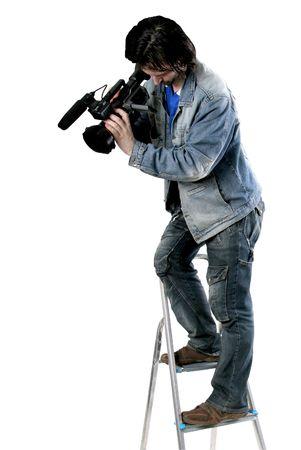 isolati cameraman dv comodo lavorare con la videocamera da step-ladder Archivio Fotografico