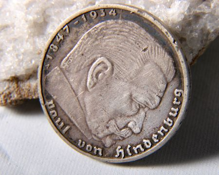 deutschemarks: silver german reichs coin of 1939 year with portrait of Paul von Hindenburg lay down at the stone