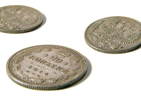 doubleheaded: isolated two sizes of the silver old russian coin with doubleheaded eagle